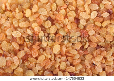 Beautiful golden raisins background