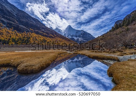 Beautiful golden Snow Mountain, Peak Jambeyang, Daocheng Yading National Park, Sichuan, China.
