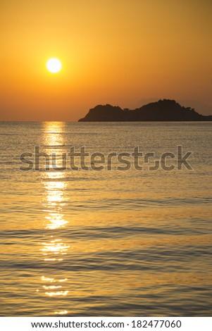 Beautiful golden sunrise on a greek island in the Mediterranean sea. - stock photo
