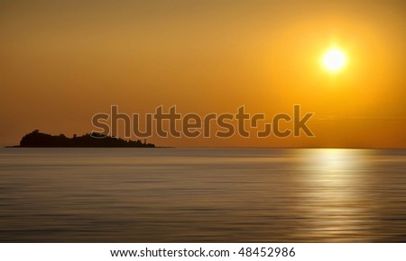 Beautiful Golden Sunset and Reflection - stock photo