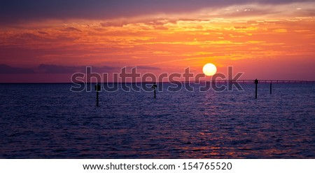 Beautiful golden sunset over the horizon in Destin, Florida - stock photo