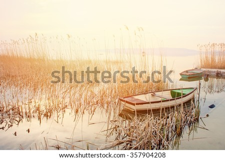 Beautiful golden sunset with rowboats  - stock photo