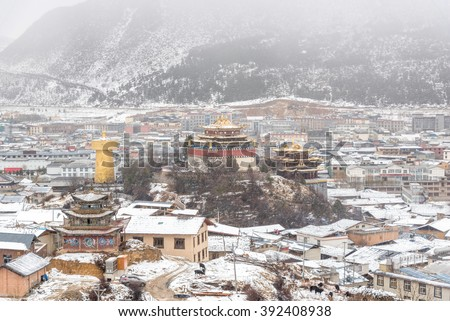 Beautiful golden temple of tibet style in snow day season at shanri la town , Yunnan , China - stock photo