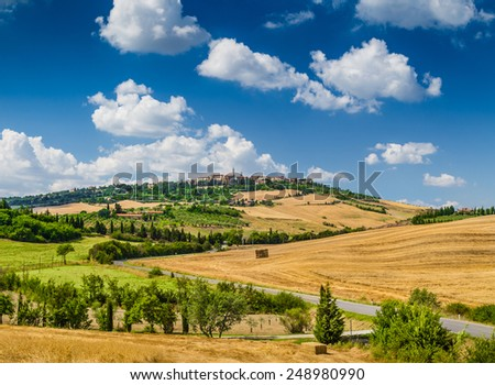 Beautiful golden Tuscany landscape with the old town of Pienza on a hill in summertime, Val d'Orcia, Italy - stock photo