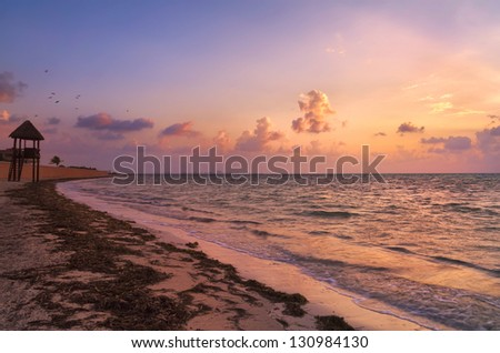 Beautiful golden yellow sunrise over the beach in Cancun, Mexico - stock photo