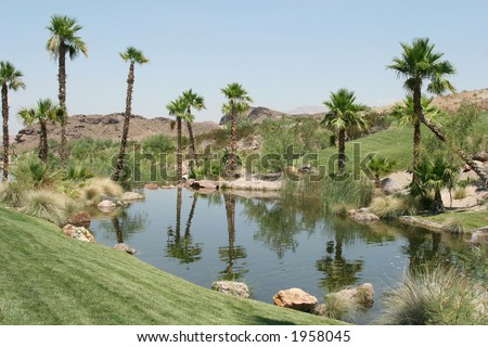 Beautiful golf course and pond - stock photo