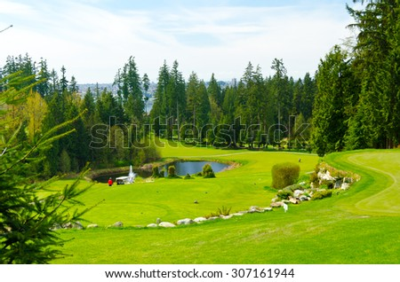 Beautiful golf course with sand bunkers. Vancouver, Canada. - stock photo