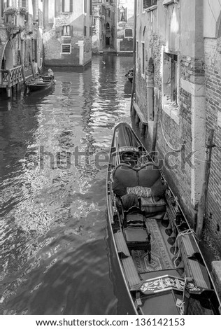 Beautiful gondola in the narrow medieval channel - Venice, Italy (black and white)