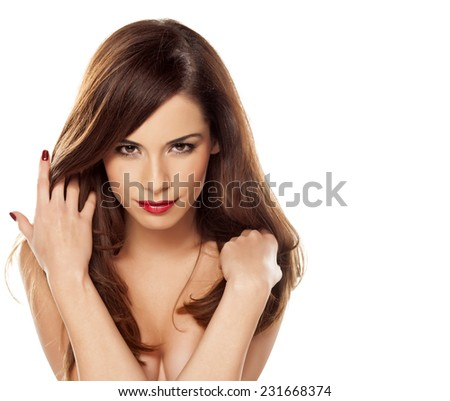 beautiful gorgeous brunette with straight hair on a white background - stock photo