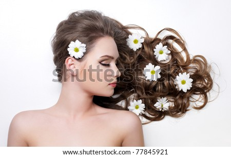 Beautiful gorgeous long curly hair of young woman - stock photo