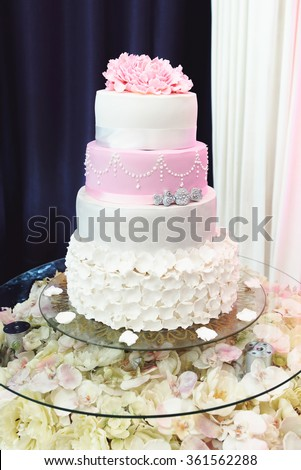 beautiful gorgeous luxury wedding colorful cake in a restaurant, celebration of a wedding