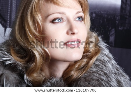 beautiful gorgeous woman portrait in fur, vintage portrait of mid adult lady in cinema - stock photo