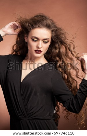 Beautiful gorgeous woman with perfect make up and hairstyle in studio photo. Beauty and fashion. Hairstyle and make up