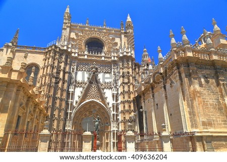Beautiful Gothic building of the Cathedral of Saint Mary of the See (Seville Cathedral) in sunny day, Seville, Andalusia, Spain - stock photo