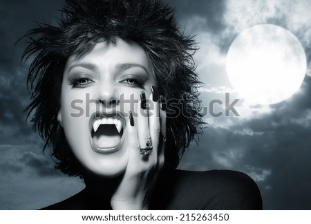Beautiful Gothic Girl. Female werewolf screaming. Monochrome Halloween concept - stock photo