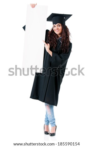 Beautiful graduate girl student in mantle showing blank placard board, isolated on white background - stock photo