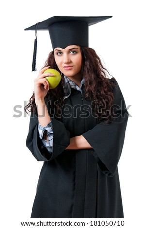 Beautiful graduate girl student in mantle with green apple, isolated on white background  - stock photo