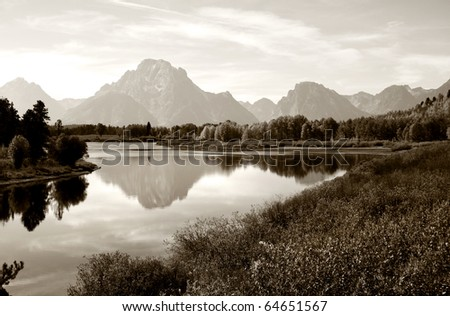 Beautiful Grand Tetons mountain range in sepia color tone - stock photo