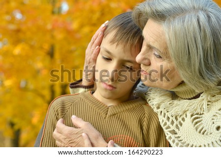 beautiful grandmother with her grandson on a walk
