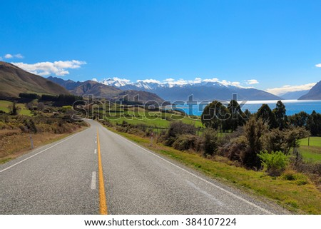 Beautiful green and snow on top of mountain landscape on highway near Lake Hawea, The South Island, New Zealand