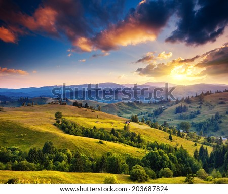 Beautiful green hills at dusk. Dramatic overcast sky. Carpathian, Ukraine, Europe. Beauty world. - stock photo