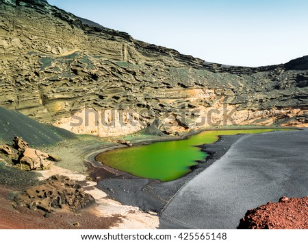 beautiful green lake Lago Verde inside crater on Lanzarote, Canary Islands, Spain - stock photo