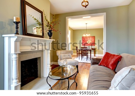 Beautiful green living room with dining room view. - stock photo
