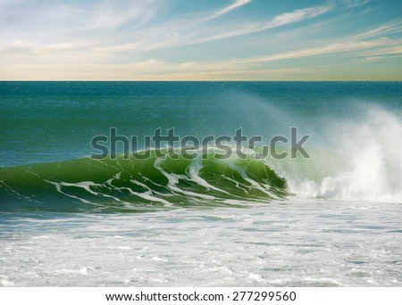 Beautiful green seascape with a perfect surfing wave - stock photo