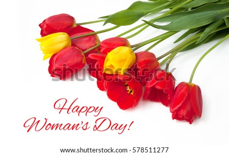 Beautiful greeting Card with text Happy Women's Day for International Women's Day, March 8. Red and yellow Tulips Flowers lie on white Background. Horizontal Image