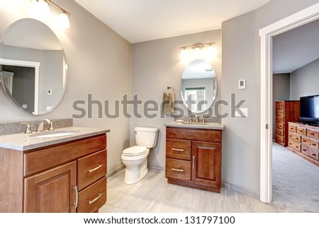 Beautiful grey new modern bathroom interior with two separate sinks. - stock photo