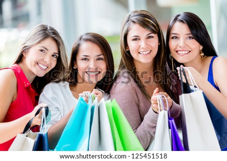 Beautiful group of shopping girls with bags - stock photo