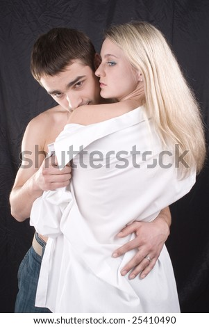 Beautiful guy and the girl on a black background - stock photo