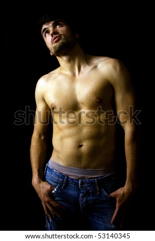 Beautiful guy with strong and sexy body on black background