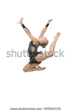 Beautiful gymnast girl jumps - stock photo