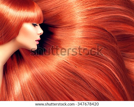 Beautiful Hair. Beauty woman with luxurious long red hair as background. Beauty model girl with healthy hair. Lady with shily smooth straight hair. Hairstyle, hair care,cair cosmetics concept - stock photo