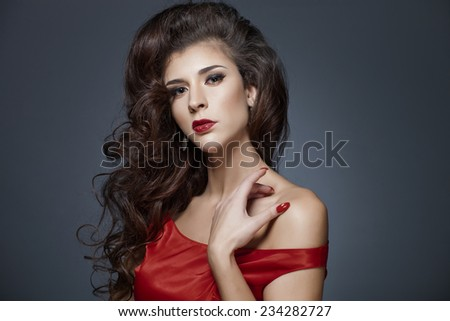 Beautiful hair, vintage portrait of an young girl in red dress