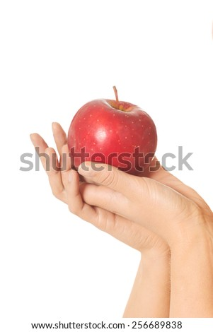 Beautiful hand holding fresh apple - stock photo