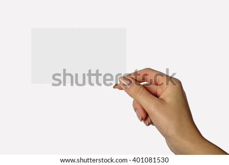 Beautiful hand of a young girl holding a card on a white background