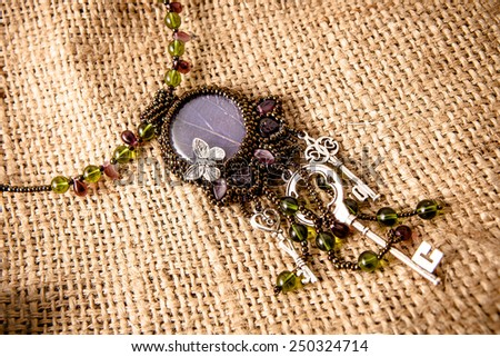 Beautiful handmade necklace with beads  - stock photo