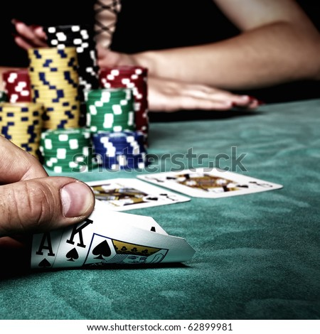 Beautiful hands holding a deck of playing cards - stock photo