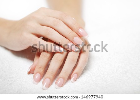 beautiful hands on the white towel