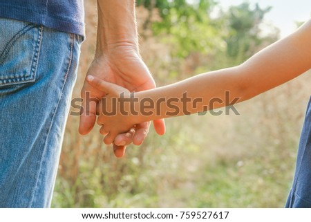 beautiful hands outdoors in a park