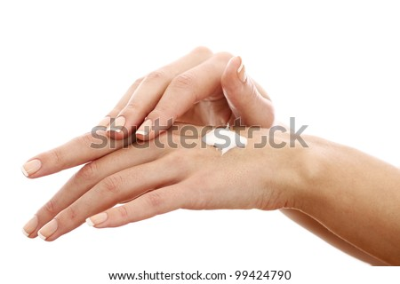 Beautiful hands with cream over white background - stock photo