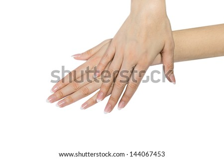 Beautiful hands with french manicure against white background, two stroking hands