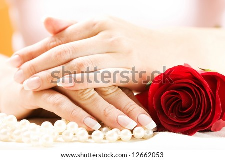 Beautiful hands with French manicure. Soft-focused, low DOF - stock photo