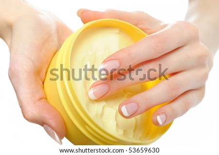 Beautiful hands with perfect nail french manicure and moisturizing cream. isolated on white background - stock photo