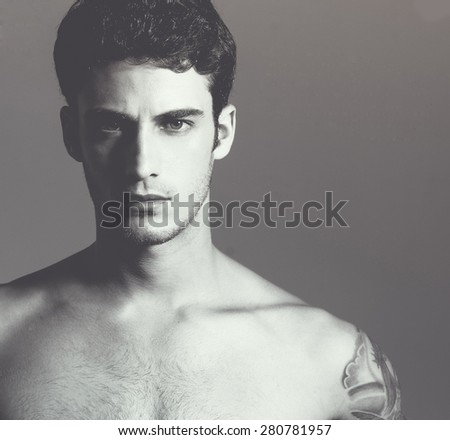 Beautiful (handsome) muscular male model with nice body. Close up. Studio portrait