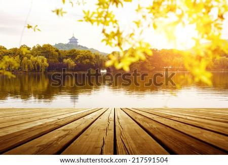 beautiful hangzhou west lake scenery,leifeng pagoda in afterglow - stock photo