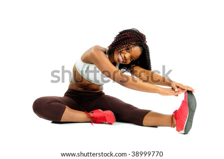 Beautiful Happy African American Woman Dressed For Fitness At The Gym Stretching Before Exercising - stock photo