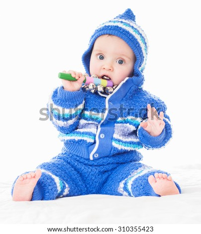 Beautiful happy baby in a blue dress . One,isolated on white.